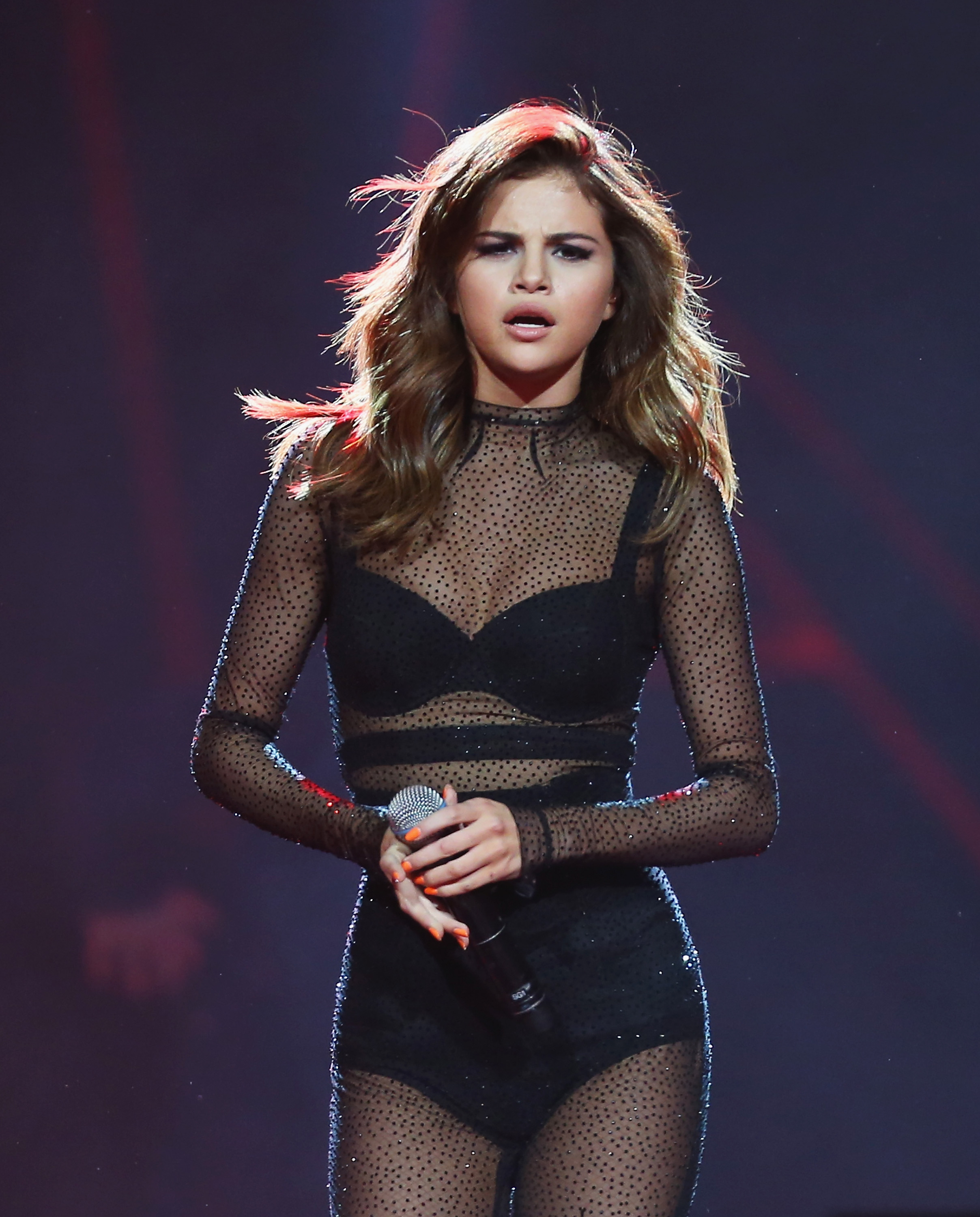 Selena Gomes on the stage - Selena Gomez Net Worth, Pics, Wallpapers, Career and Biography