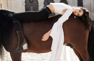 Kendall Jenner Lying On The Horse Posing 300x195 - Hot Kendall Jenner Sportive