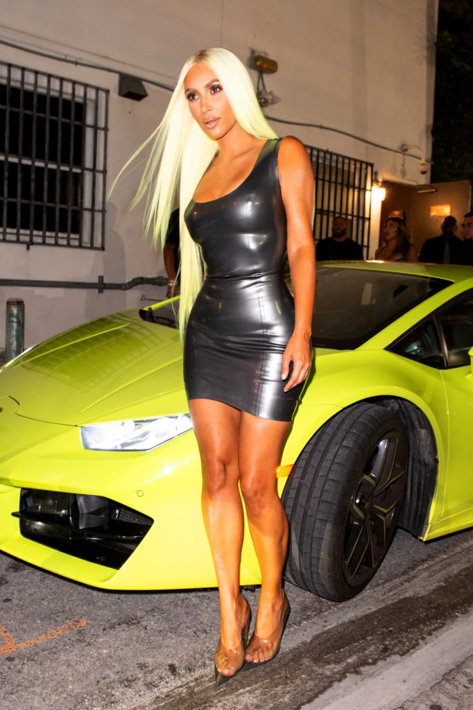 Kim Kardashian With Car 682x1024 - Kim Kardashian Yellow Hair