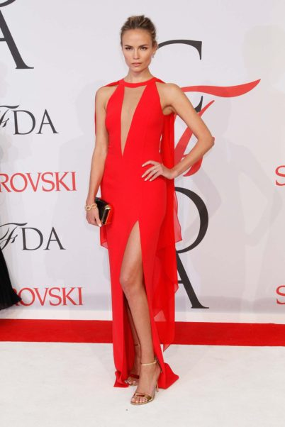 Natasha Poly Red Revealing Dress And A Deep Slash