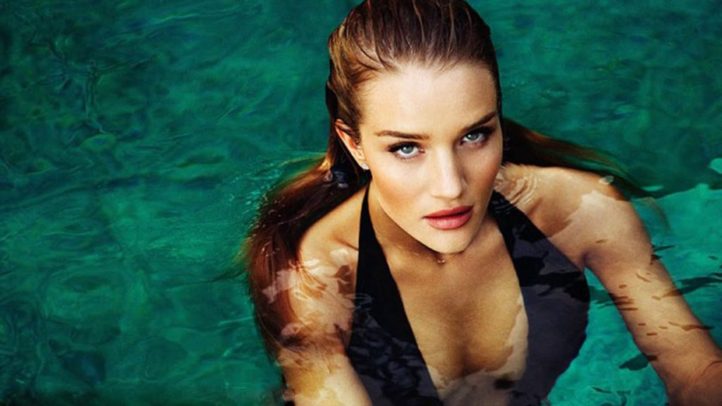 Rosie Huntington Whiteley Hot Pose In The Sea 1024x576 - Rosie Huntington-Whiteley Net Worth, Pics, Wallpapers, Career and Biograph