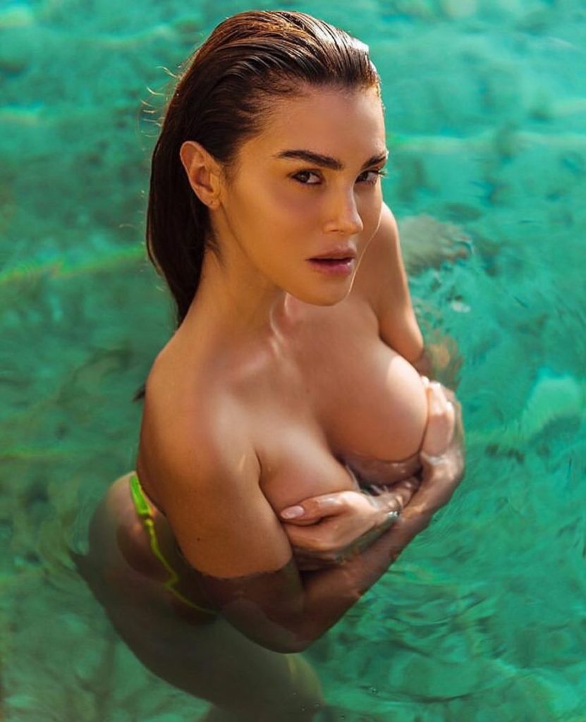 Silvia Caruso In The Sea 831x1024 - Silvia Caruso Net Worth, Pics, Wallpapers, Career and Biography