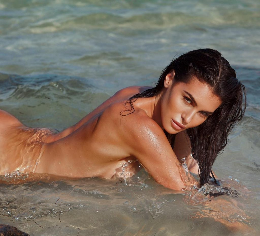 Silvia Caruso Super Pose In The Sea 1024x931 - Silvia Caruso Net Worth, Pics, Wallpapers, Career and Biography