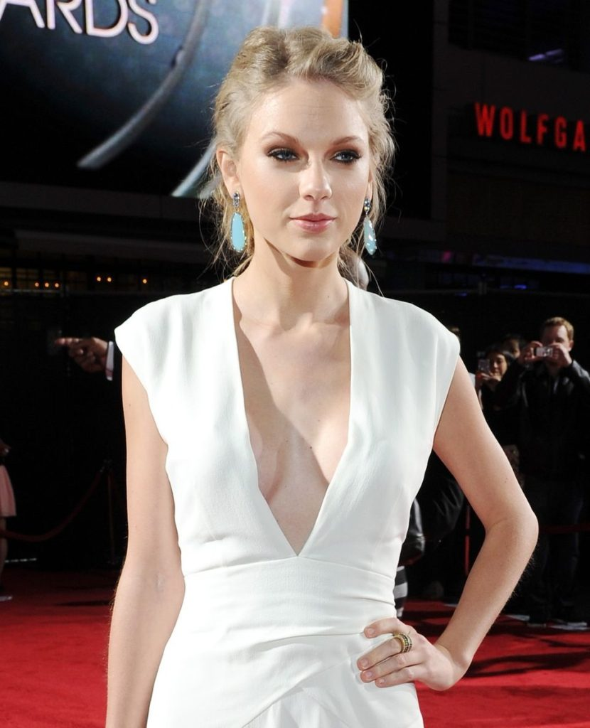 Taylor Swift White Revealing Dress 830x1024 - Taylor Swift White Revealing Dress