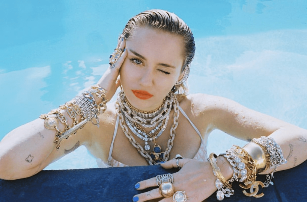 Miley Cyrus Hot Pool Pose Photos 1024x676 - Miley Cyrus Net Worth, Pics, Wallpapers, Career and Biography