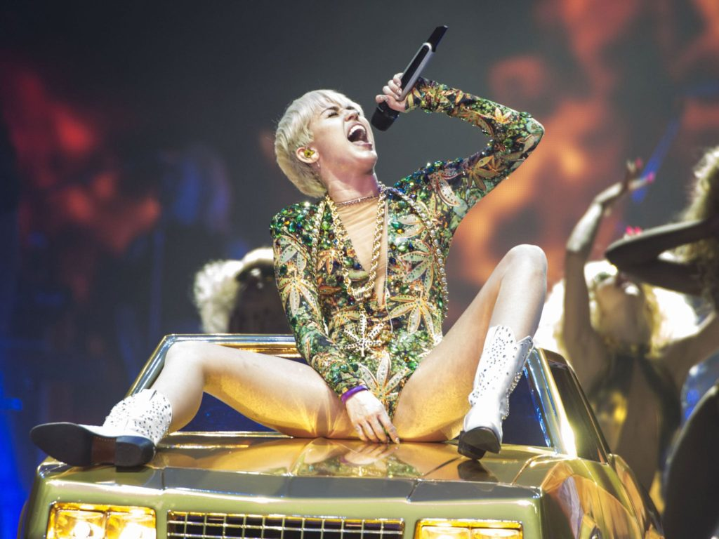 Miley Cyrus Live Concert Pics 1024x768 - Miley Cyrus Net Worth, Pics, Wallpapers, Career and Biography