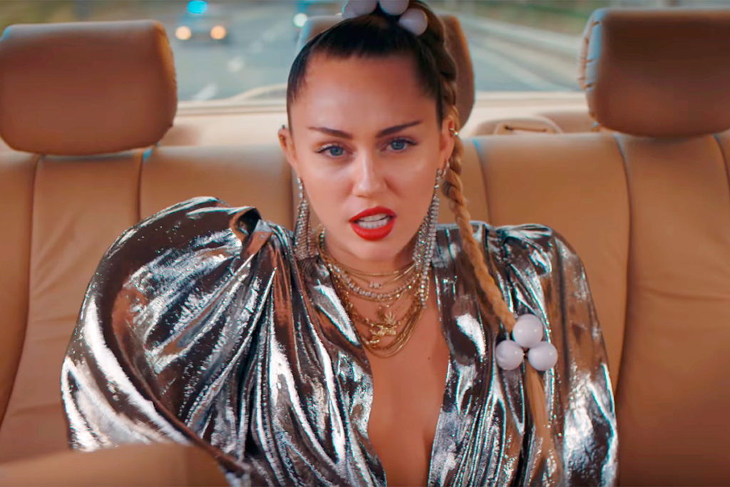 Miley Cyrus Music Clip Scene Pics 1024x683 - Miley Cyrus Net Worth, Pics, Wallpapers, Career and Biography