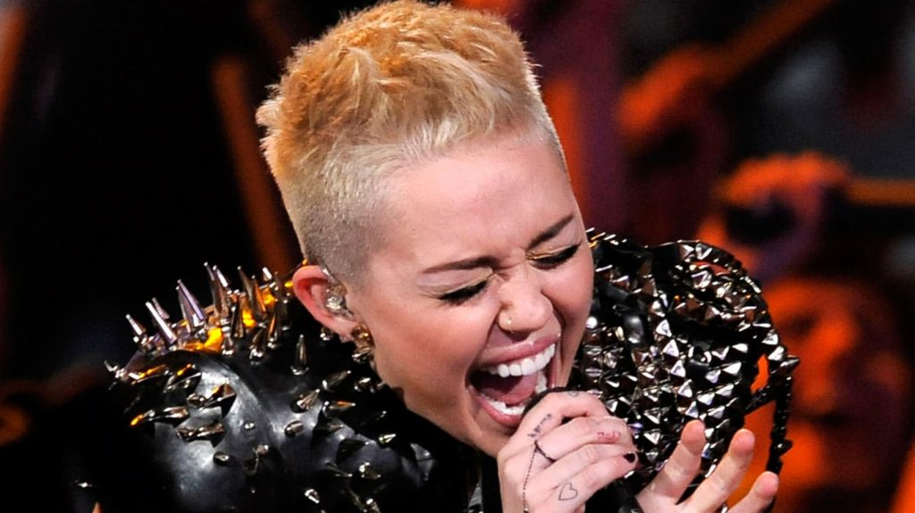 Miley Cyrus Singing Wallpapers 1024x575 - Miley Cyrus Net Worth, Pics, Wallpapers, Career and Biography